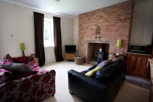 An Image Of The Living Room In Inglenook Cottage